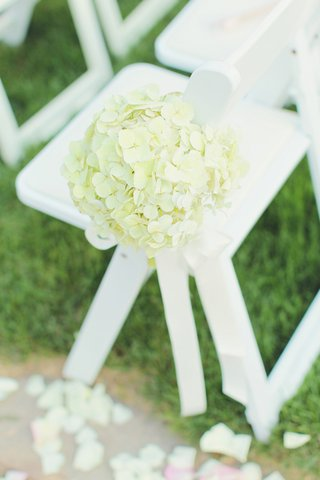 ivory-hydrangeas-attached-to-white-wooden-chair