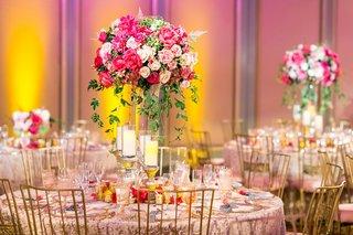 texture-linen-pink-rose-dahlia-greenery-centerpiece-pillar-candles-on-stands-gold-chairs-uplight