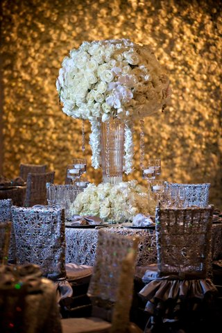 tall-flower-arrangement-centerpiece-with-white-orchid-and-ivory-rose-flowers-in-front-of-flower-wall