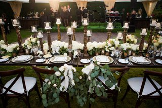 wedding-reception-wood-dance-floor-wood-table-vineyard-chairs-greenery-white-flowers-antique-candles