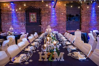 wedding-reception-venue-with-brick-wall-and-blue-lighting