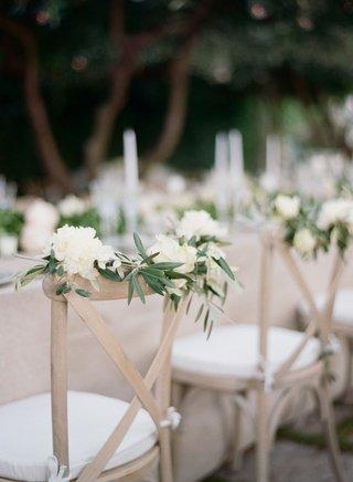 vineyard-chair-white-cushion-whitewash-wood-with-white-peony-white-rose-green-leaves-greenery-decor
