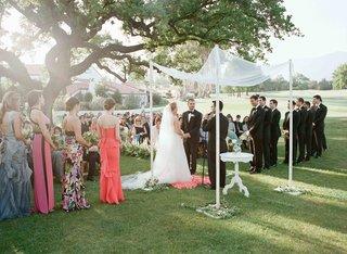 bride-and-groom-under-chuppah-and-ojai-oak-tree