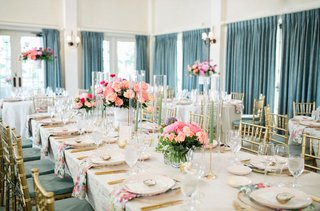 wedding-reception-pink-coral-peony-flower-centerpieces-sage-green-gold-curtains-chairs