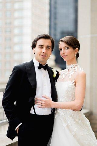 bride-in-angel-sanchez-gown-and-groom-in-tuxedo