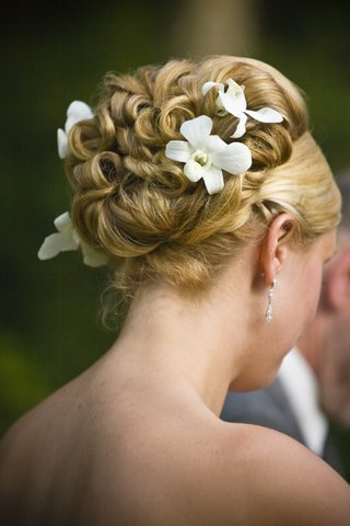 intricate-curly-updo-bridal-wedding-hair-with-fresh-orchid-flowers