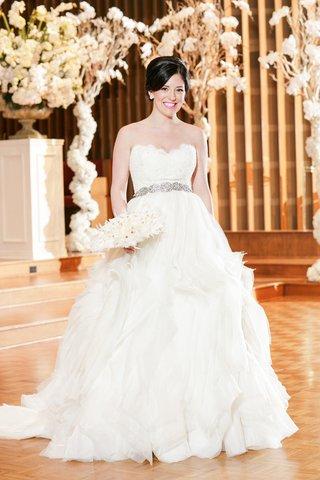bride-in-strapless-lazaro-ball-gown-with-ruffled-skirt-and-beaded-belt
