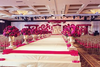 south-indian-american-wedding-ceremony-elevated-aisle-line-with-arrangements-of-fuchsia-flowers