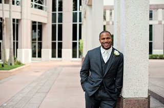 african-american-man-in-tuxedo-leaning-against-pillar