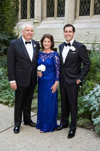 groom-in-tuxedo-with-mother-of-bride-in-floor-length-cobalt-blue-mother-of-bride-dress-lace-sheer