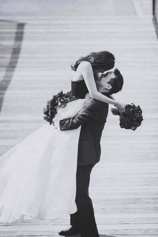 black-and-white-photo-of-groom-picking-up-bride