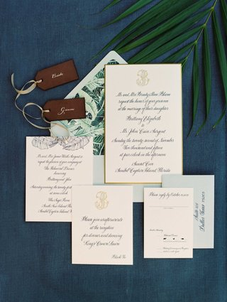 destination-wedding-invitation-with-blue-calligraphy-palm-tree-frond-envelope-liner-travel-tags