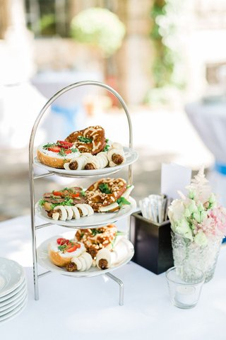 wedding-ceremony-cocktail-hour-three-tier-tea-stand-tea-sized-sandwiches-and-german-food
