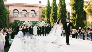 cheryl-burke-and-matthew-lawrence-wedding-ceremony-outdoor-venue-white-black-greenery-recessional