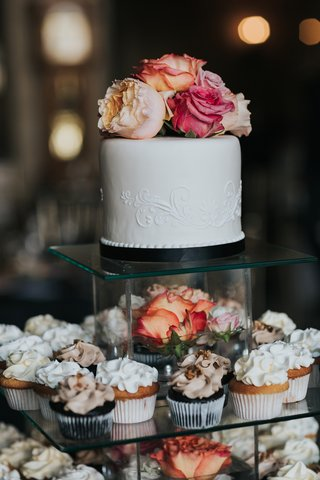 mini-wedding-cake-with-cupcakes-displayed