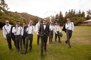 men-in-suspenders-with-ferris-wheel-backdrop