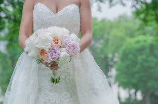 bridal-bouquet-with-ivory-and-blush-peonies-and-peach-garden-roses