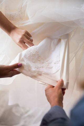 lace-from-mother-of-the-brides-veil-being-added-to-daughters-wedding-dress