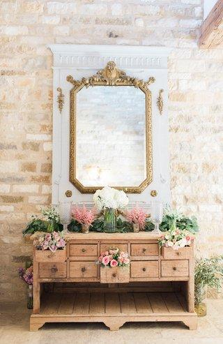 pitch-perfect-stars-anna-camp-skylar-astin-wedding-wooden-dresser-pink-white-flowers-ceremony-decor