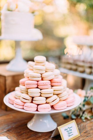 wedding-reception-dessert-table-white-cake-stand-with-pink-white-macaron-desserts