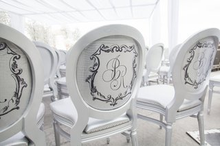 white-round-back-chair-silver-cushions-and-backs-snakeskin-monogram-on-every-guest-seat-same-sex