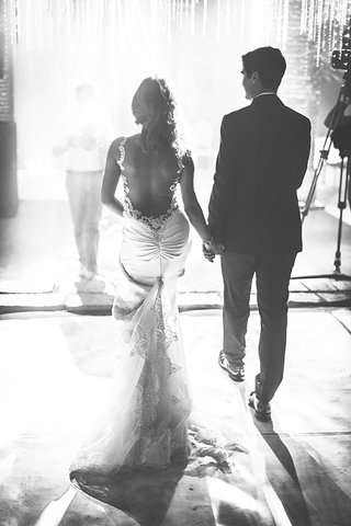 black-and-white-photo-of-couple-walking-away-wedding-destination-morocco-marrakech-galia-lahav-dress