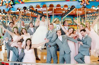 wedding-venue-in-cincinnati-with-carousel-bridesmaids-in-pink-dresses-and-flower-crowns