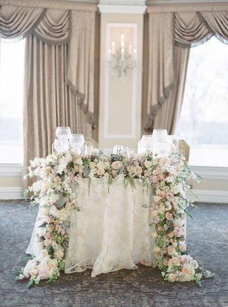 wedding-reception-at-oheka-castle-sweetheart-table-flower-garland-greenery-pink-ivory-embroidery