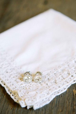 brides-diamond-pave-stud-earrings-on-handkerchief-with-lace-trim
