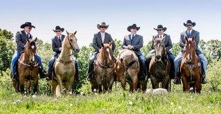 groom-and-groomsmen-in-cowboy-hats-and-jeans-on-horses