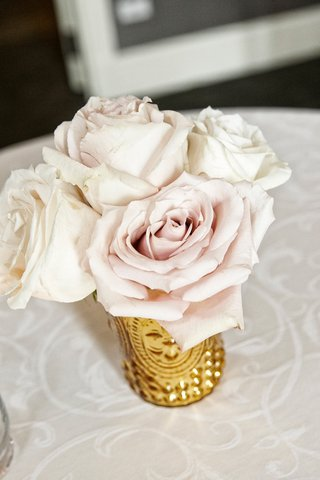 ivory-and-blush-roses-in-a-gold-vase-at-wedding-cocktail-table