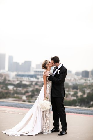 four seasons hotel los angeles at beverly hills wedding venue rooftop couple portraits