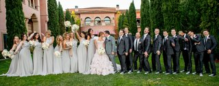 bride-in-ruffle-mark-zunino-wedding-dress-with-bridesmaids-in-grey-and-groomsmen-in-converse