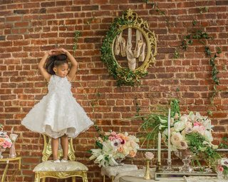 pantora-mini-flower-girl-dress-with-flare-skirt-and-ruffled-floral-details-ballet-pose
