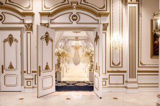 wedding-ceremony-decor-visible-through-doorway-of-ballroom-at-the-legacy-castle-in-new-jersey