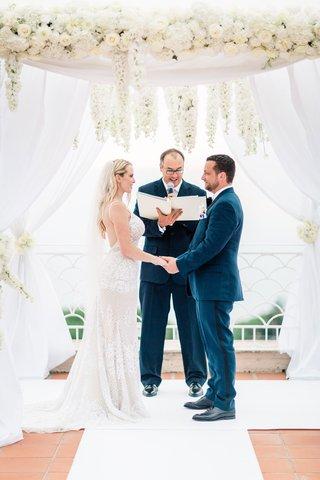 destination-wedding-in-capri-bride-in-galia-lahav-wedding-dress-groom-in-navy-suit-white-canopy