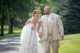 bride-in-pronovias-gown-with-illusion-neckline-lace-bodice-groom-in-tan-suit-brian-winters-ny-jets