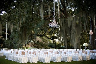 white-ceremony-chair-covers-at-outdoor-plantation-wedding-ceremony-under-large-oak-trees