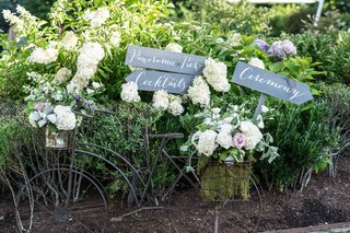 vintage-inspired-directional-signs-pointing-guests-in-the-right-direction-foliage-vintage-bicycle