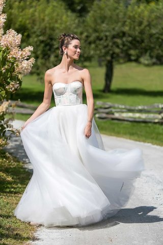 bride-in-strapless-carolina-herrera-wedding-dress-pink-green-flower-print-design-on-bodice-tulle