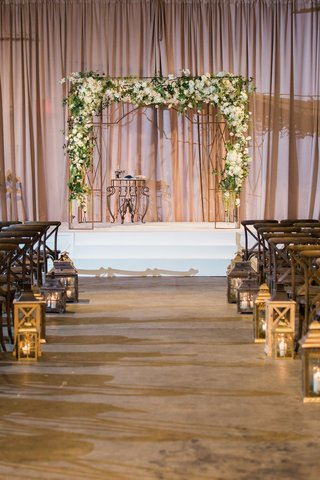 chuppah-with-white-flowers-green-leaves-and-twigs-jewish-wedding