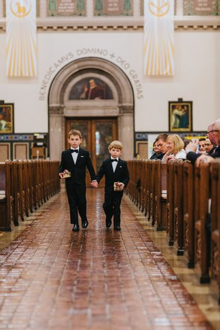 two-ring-bearers-in-tuxedos-holding-hands-two-ring-bearers-each-with-a-ring-box