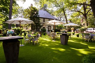 cocktail-hour-on-grass-lawn-in-backyard-of-tudor-style-home-in-illinois