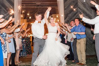 bride-in-wedding-dress-illusion-long-sleeves-dancing-twirl-in-tunnel-of-sparklers-wedding-exit