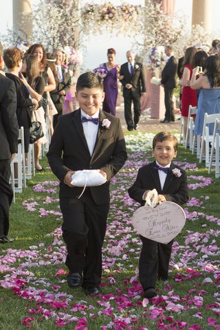 two-latin-boys-walking-down-petal-covered-aisle