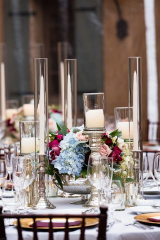 taper-candles-and-pillar-candles-on-mercury-glass-stands-with-multicolored-centerpiece