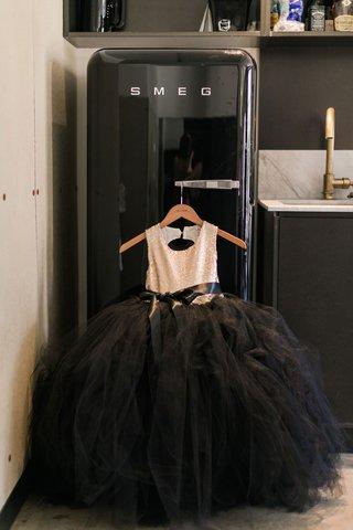 black-tulle-skirt-ball-gown-flower-girl-dress-gold-sequin-bodice-on-hanger-smeg-refrigerator-fridge