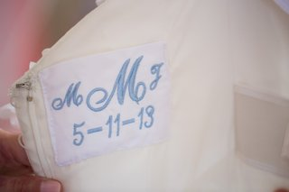 monogram-and-wedding-date-woven-into-wedding-dress