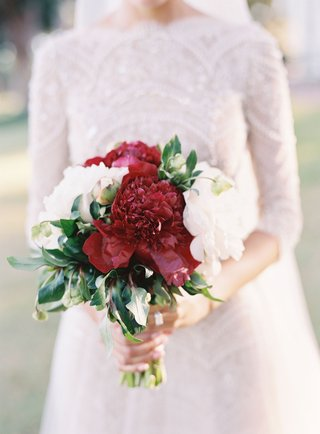 bride-carrying-burgundy-peony-and-white-peony-flower-bouquet-for-wedding-lace-top-and-skirt-dress