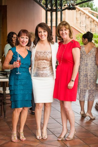 bride-to-be-in-white-suit-gold-sequined-blouse-with-guests-at-amaya-restaurant-the-grand-del-mar